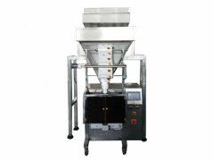 Multi head electronic weighing particle packing machine